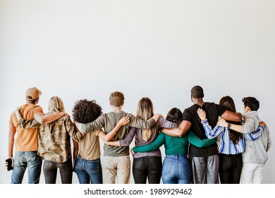 Rearview of diverse people hugging each other - Shutterstock ID 1989929462