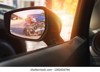 Rearview mirror with a car - car accident concept