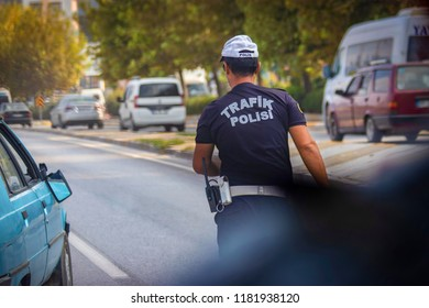 rear-view-polish-police-officer in middle of street