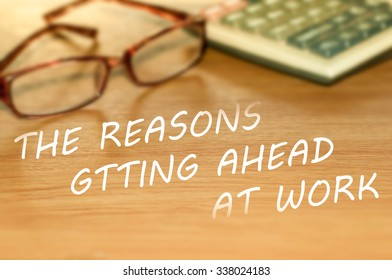 THE REASONS GTTING AHEAD AT WORK message on the table