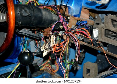Reassembly of an old collector car with wiring spread throughout the steering and dash area for testing repair and install.