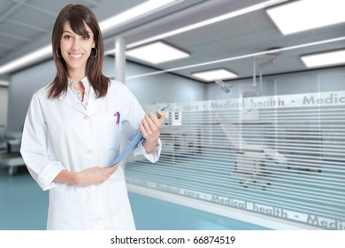 Reassuring medical professional with a folder  in a modern clinic