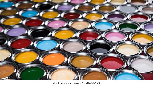 reativity concept group of tin metal cans with color paint