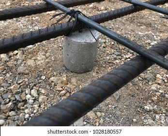 Rebar for concrete slab or pavement work set ting on ground by small concrete protect rebar attach to soil before casting concrete