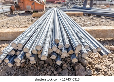 Rebar. Its surface is often deformed to promote a better bond with the concrete. The most common type of rebar is carbon steel, typically consisting of hot-rolled round bars with deformation patterns.