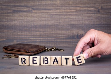Rebate. Wooden letters on dark background