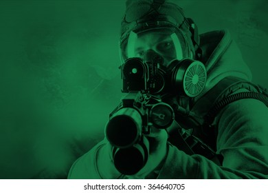 rebel man with gas mask and rifles against a apocalypse background