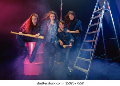 Rebel youth. Full length portrait of cocky children in stylish jeans and leather clothes. Concept of teenage riot, kids fashion, nonconformism and young energy. Modern lifestyle.