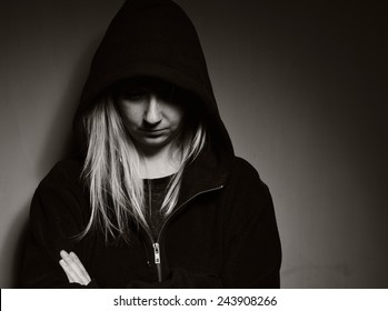 Rebellious teenager in a hoodie. MANY OTHER PHOTOS FROM THIS SERIES IN MY PORTFOLIO.