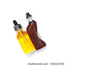 rebuildable tank atomizer with high end stabilized redwood burl regulated box mods and e-liquid bottle on white texture background, vaping device