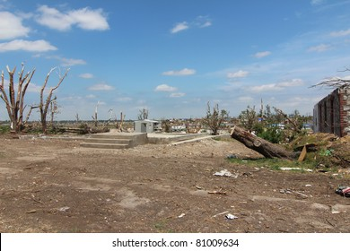 Rebuilding begins after a devastating EF-5 tornado by first clearing the grounds and home foundations of debris.