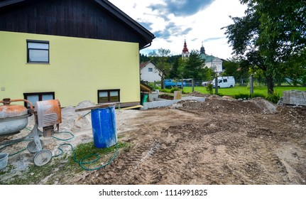 Rebuilding a family house and adding an extension. Setting up a construction site with tools and construction material for residential construction project.