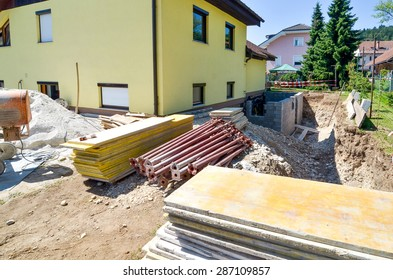 Rebuilding a family house and adding an  extension. Setting up a construction site.
