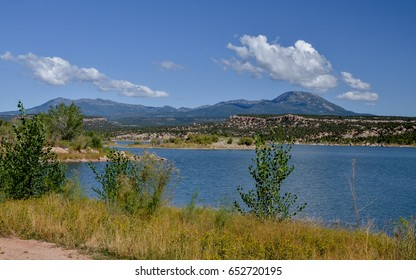 Recapture Reservoir with white clouds over Abajo Mountains in the background Blanding, San Juan County, Utah, United States