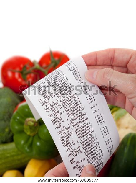 A Receipt over bag full of vegetables