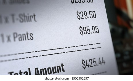 Receipt Paper With Total Amount With Selective Focus and Blurry Image
