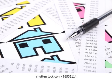 receipts and house with pen