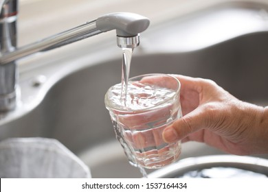 Receive a cup of overflowing water