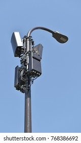 receivers and transmitters on a light pole blue sky background