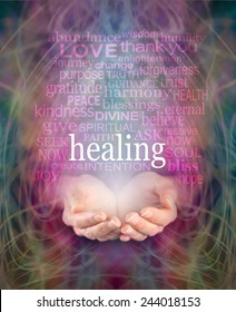 Receiving healing - Female cupped hands with the word 'healing' floating above surrounded by a word cloud of healing related words on a swirling misty energy background