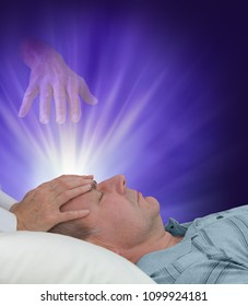Receiving healing from the other side - female hands laid gently on forehead of a man  relaxing and an ethereal helping hand reaching down from spirit world