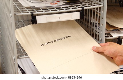 Receiving a private and confidential envelope in the office mailroom.