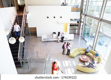office reception areas. a reception area of modern office building with people