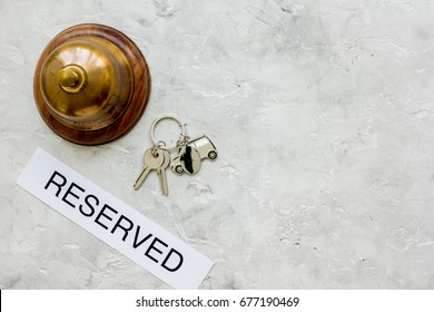 reception desk in hotel with ring and keys gray background top view space for text