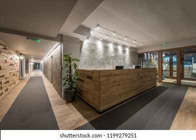 Reception desk and view on hallway in modern hotel