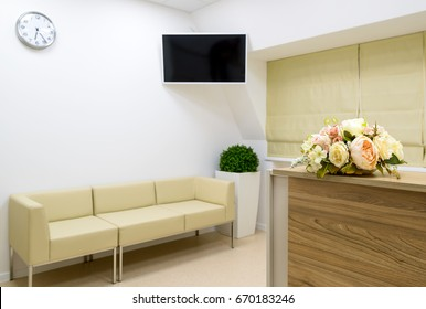Reception with flower on the blurred clinic or office background