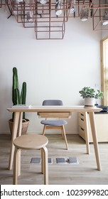 reception in scandinavian style with real cactus in background/nordic mood/cozy interior concept