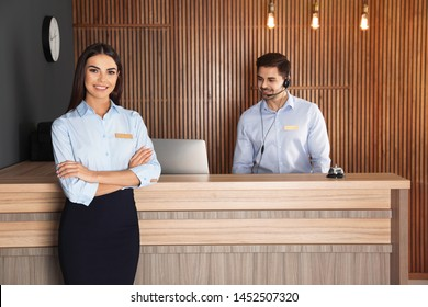 Receptionist at desk with colleague in lobby
