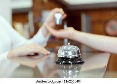 receptionist giving key