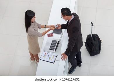 Receptionist Talk to a businessman.