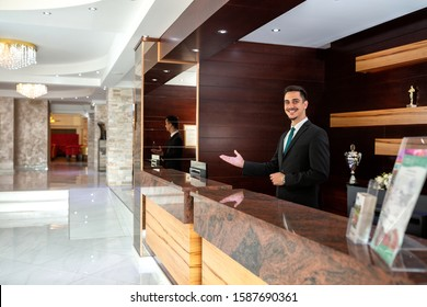 Receptionist welcoming guests to a hotel, concept of tourism
