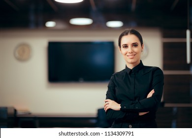 Receptionist Woman in front of Her Desk Greeting Customers. Portrait of a front desk officer at her workplace