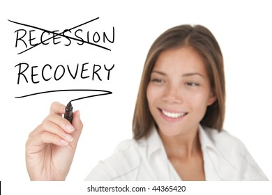 Recession and recovery economy concept.Young beautiful businesswoman with pen writing on whiteboard. Focus on the black marker. Mixed race chinese / caucasian model isolated on white background.