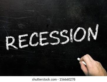 Recession written in chalk on a blackboard.