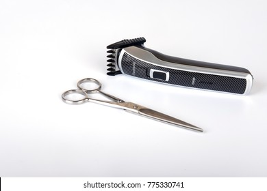 Rechargeable hair clipper and scissor isolated on white background