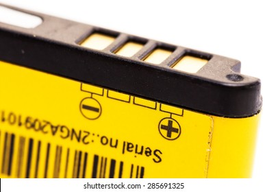 Rechargeable Lithium Ion Mobile Phone Battery. Isolated on white background. Small depth of field. Yellow color grainy