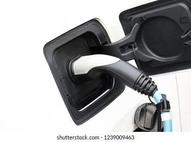 Recharging of an an electric car with a plug and cable