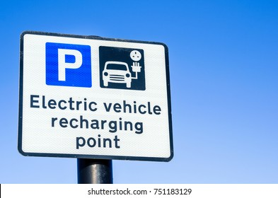 Recharging Point for Electric Vehicles Sign against Clear Sky