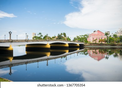 Recife, Brazil - Circa April 2019: Bridge and a view of the historic neighborhood Santo Antonio reflecting on the waters of the Capibaribe river