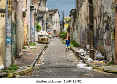 Recife, Brazil - Circa April 2019: Street in Boa Vista neighborhood with decaying buildings and lots of trash - a big part of the historic center of Recife is completely abandoned and decaying rapidly