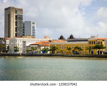Recife, Brazil - Circa December 2018: A view of Capibaribe river and Old Recife's cityscape