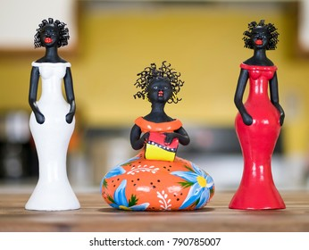 RECIFE, BRAZIL - JANUARY 5: Little clay sculptures representing Afro-Brazilian women dressed in colorful local costumes used as home decoration in the Northeast of Brazil on January 5, 2018.