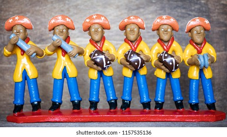 RECIFE, BRAZIL - JUNE 20, 2018: Traditional clay sculptures, made in Caruaru,  painted with vibrant colors representing a Forro band used as home decoration in the Northeast of Brazil.