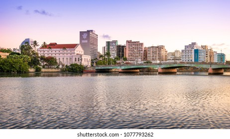 RECIFE, BRAZIL - MARCH 20, 2018: The skyline of the historic city of Recife in Pernambuco, Brazil by the Capibaribe River at sunset.