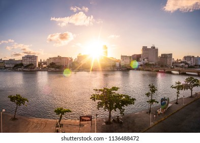 RECIFE, BRAZIL - MARCH 20, 2018: The historic architecture of Recife in Pernambuco, Brazil at sunset by the Capibaribe river.