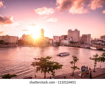 RECIFE, BRAZIL - MARCH 22, 2018: The historic architecture of Recife in Pernambuco, Brazil by the Capibaribe river at sunset.